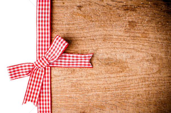 Wooden background with a red checkered ribbon Stock photo © manera