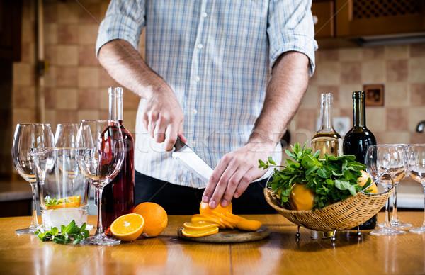Man cuts oranges  Stock photo © manera