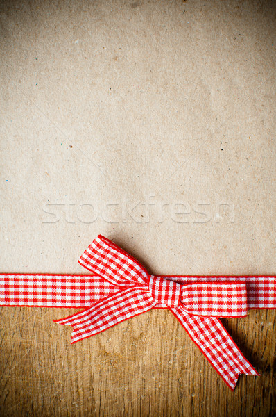 Wooden background, ribbon and kraft paper Stock photo © manera