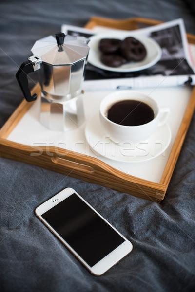 Caffè colazione letto smartphone magazine Foto d'archivio © manera