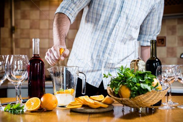 man squeezes orange Stock photo © manera