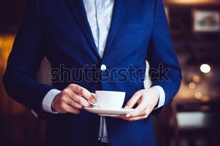 Foto stock: Pie · taza · café · empresario · azul · chaqueta