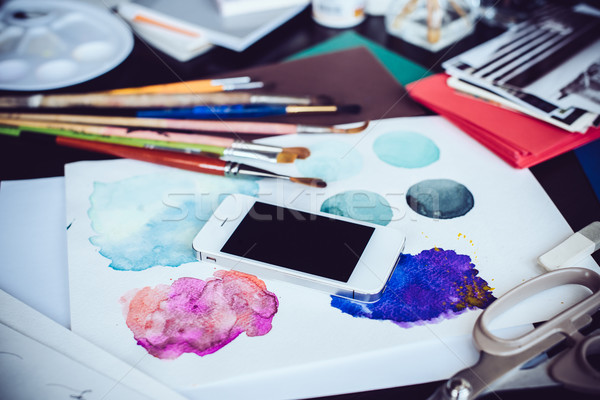 Smartphone on a table in the artist studio Stock photo © manera