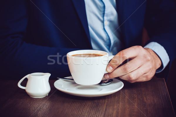ストックフォト: 男 · カフェ · ビジネスマン · 青 · ジャケット · カップ