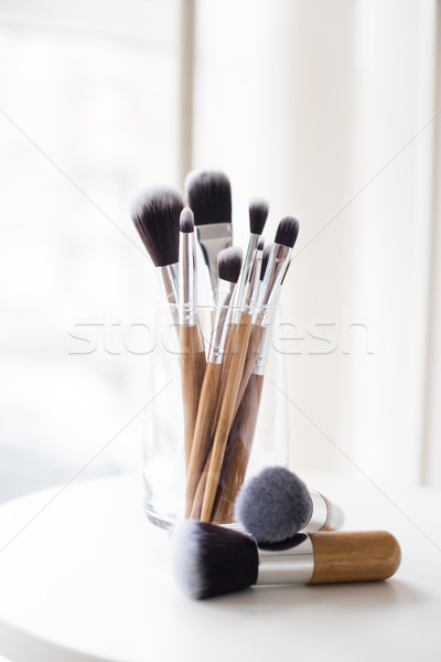 Professional makeup brushes in a glass Stock photo © manera