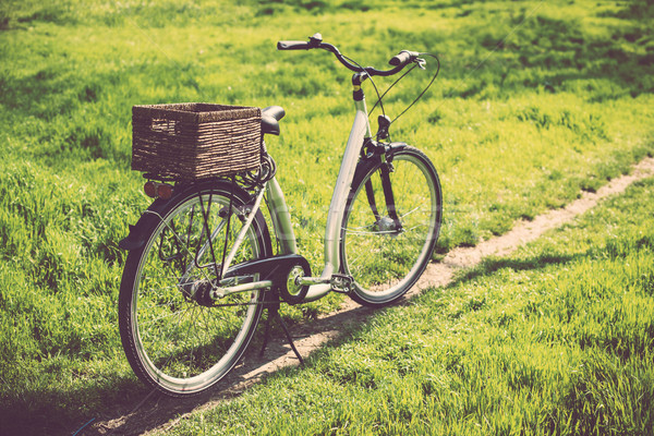 bicycle with a wicker basket Stock photo © manera