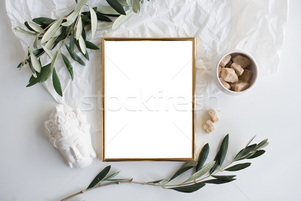 Golden frame mock-up on white tabletop Stock photo © manera