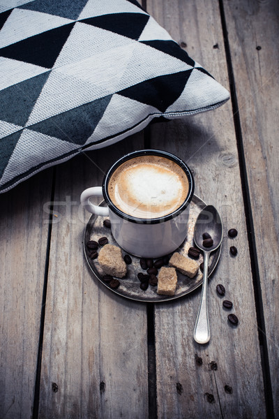 cup of coffee and pillow on wooden floor Stock photo © manera