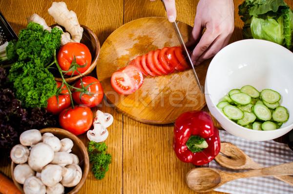 Man cuts fresh spring vegetables Stock photo © manera