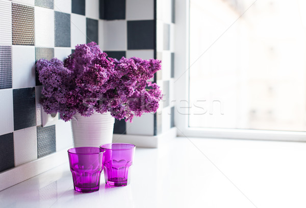 lilacs in a vase and glasses Stock photo © manera