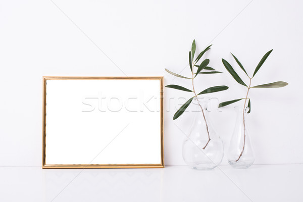 Golden frame mock-up on white wall Stock photo © manera