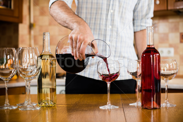 man pours red wine  Stock photo © manera