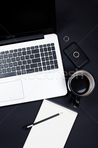Businessman desk workspace with laptop keyboard, coffee and note Stock photo © manera