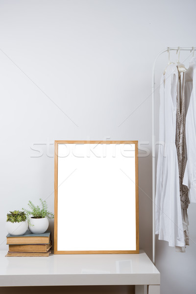 Empty wooden picture frame on the table, art print mock-up Stock photo © manera