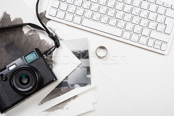 Stock photo: Styled tabletop with computer keyboard and retro camera on white