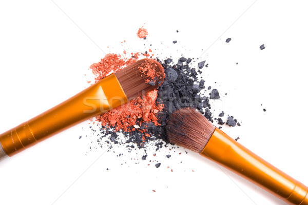 Professional makeup brushes set and loose powder eyeshadows isol Stock photo © manera