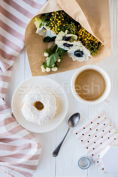 coffe and a donut with fresh flowers Stock photo © manera