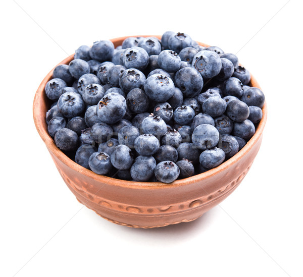 Bowl of ripe blueberries isolated on white Stock photo © manera