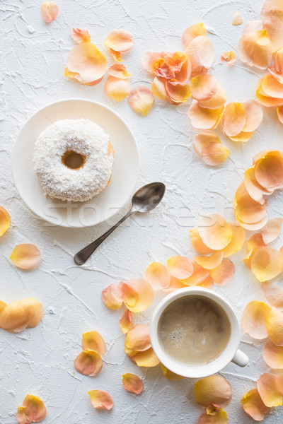 Cup of coffe and a donut on white textured background Stock photo © manera