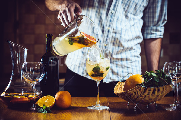 Man pours white homemade sangria Stock photo © manera
