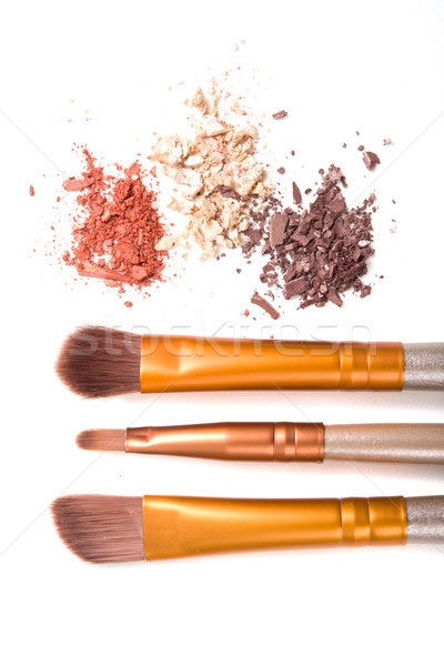 Makeup brushes set and loose eyeshadows isolated Stock photo © manera