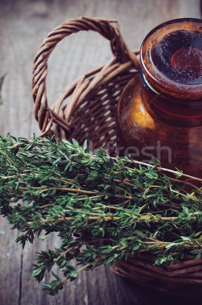 pharmacy bottle and thyme in a basket  Stock photo © manera