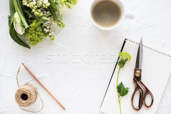 Feminine flatlay with flowers and ccoffee on white tabletop Stock photo © manera