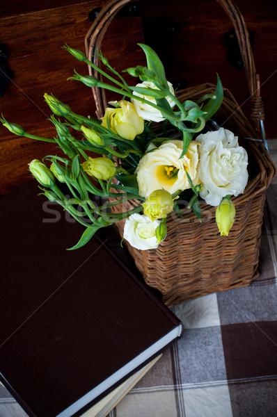 Bukiet żółte kwiaty wiklina koszyka książek Zdjęcia stock © manera