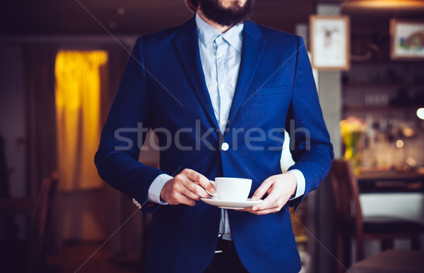standing with a cup of coffee Stock photo © manera