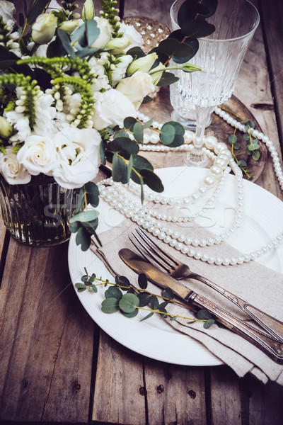 Vintage wedding table decor, tableware, flowers and pearl beads Stock photo © manera