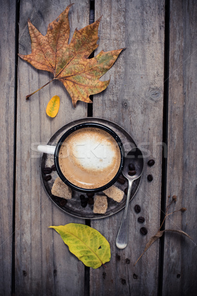 Cozy autumn, cup of coffee and yellow leaves Stock photo © manera