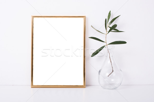 Stock photo: Golden frame mock-up on white wall