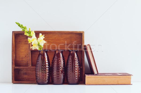 Klasszikus lakberendezés három barna üveg virág Stock fotó © manera