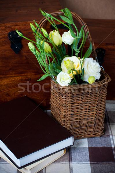żółte kwiaty wiklina koszyka bukiet książek Zdjęcia stock © manera