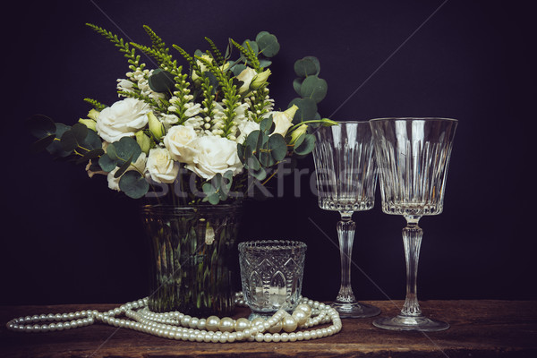 bouquet of white flowers, pearl beads and wine glasses on a blac Stock photo © manera