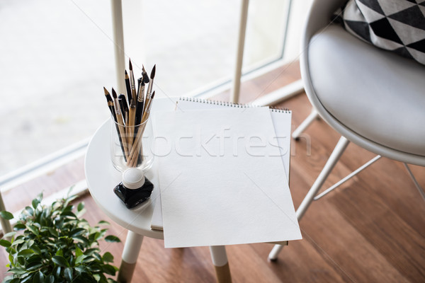 Creative artist's workspace, artistic paint brushes and paper Stock photo © manera