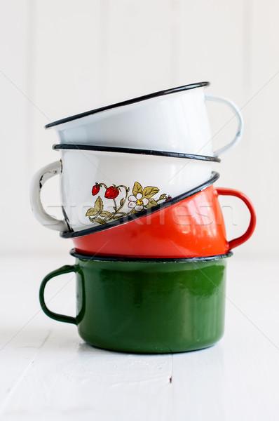 three bright colorful enameled mugs Stock photo © manera