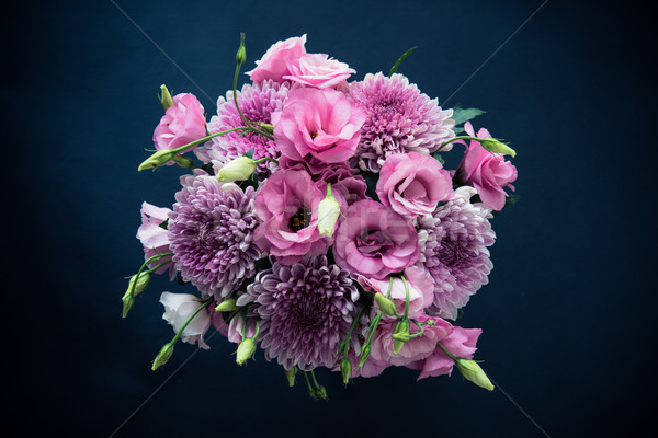Bouquet of pink flowers closeup on black background Stock photo © manera