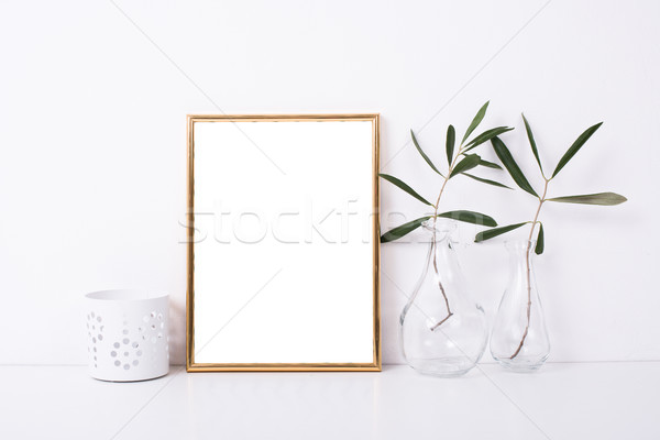Golden frame mock-up on white wall Stock photo © manera