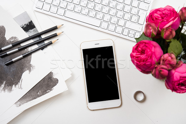 smartphone, computer keyboard and fesh pink flowers on white tab Stock photo © manera