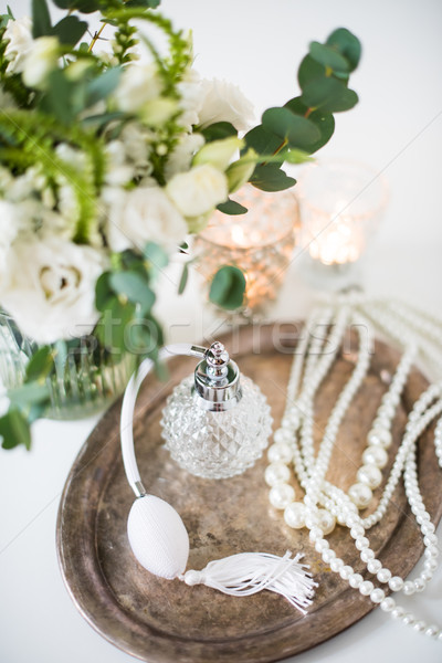 white wedding decor, perfume, pearl beads and bouquet of flowers Stock photo © manera