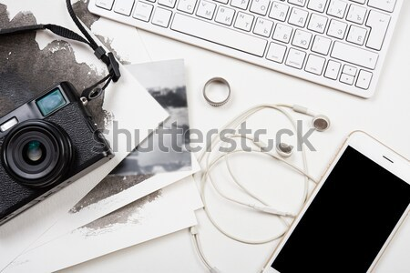Styled tabletop with computer keyboard and retro camera on white Stock photo © manera
