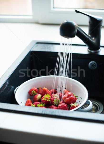 organic strawberries in colander Stock photo © manera