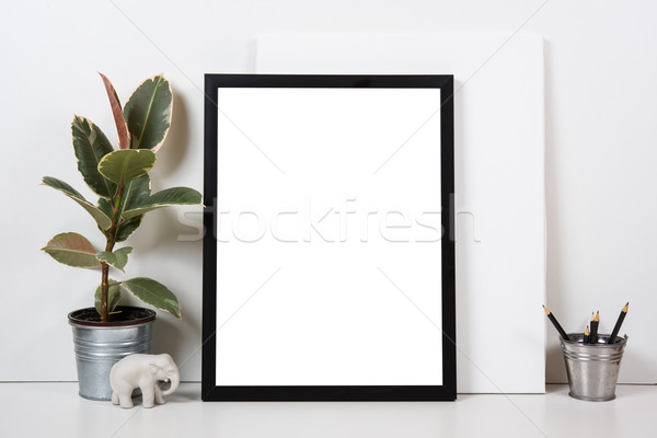 Stock photo: Styled tabletop, empty frame, painting art poster interior mock-