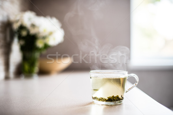 Cup of fresh green tea with steam Stock photo © manera