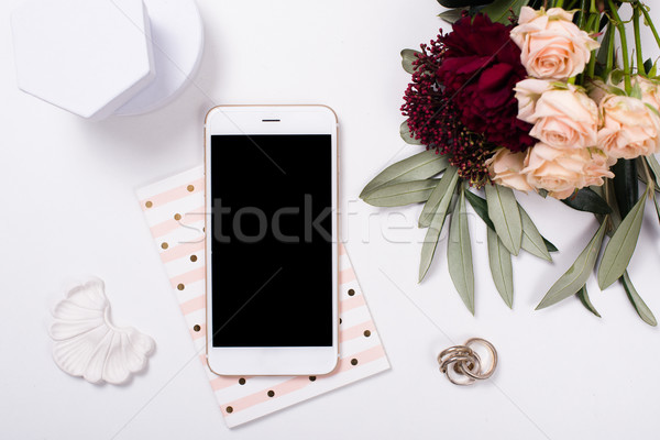 Stock photo:  feminine tabletop flatlay with smartphone mock-up