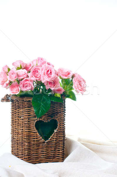 pink roses in a wicker basket and linen fabric Stock photo © manera