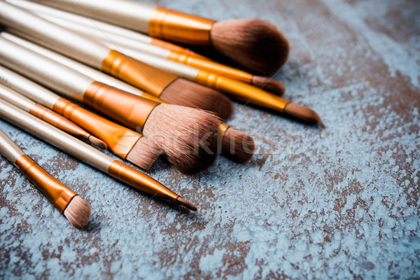 makeup brushes collection, new make-up tools set on painted back Stock photo © manera
