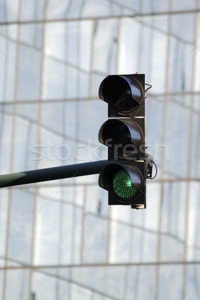 Zöld jelzőlámpa üveg homlokzat irodaház ablak Stock fotó © manfredxy