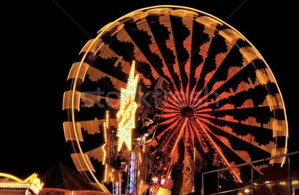 Illuminated ferris wheel at night Stock photo © manfredxy